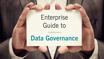 Hands holding card that reads 'Enterprise Guide to Data Governance'