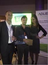 Tomáš Bernát from Skoda Auto, who won the Amazon Kindle, shown here with Tieme Stoutjesdijk of Adlib and Ewa Jozefowicz, Field Marketing Specialist, Program Management, EuroCentral.