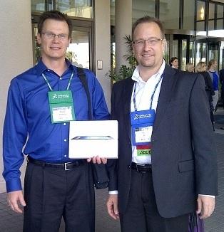 iPad winner Bryan Hanson with Adlib President and CEO Peter Duff