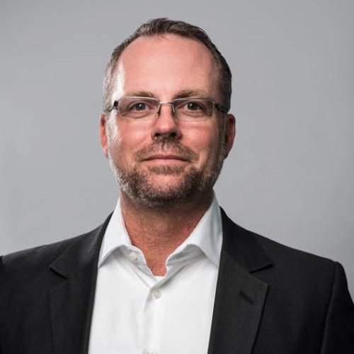 A head shot of Scott Mackey, SVP of Market Strategy at Adlib Software.